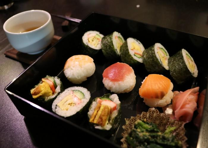 Bento box filled with a variety of sushi rolls during a Japanese Sushi Making Class in KYoto