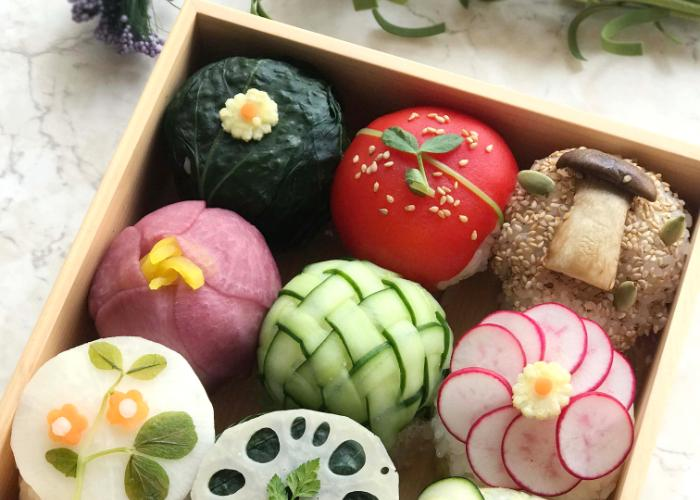 9 types of sushi in a bento beautifully decorated with vegetables during the Kawaii Vegetarian Sushi Cooking Class in Tokyo