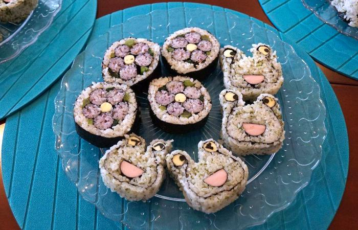 Frog and flower-shaped sushi rolls during the Decorative Sushi Class in Tokyo