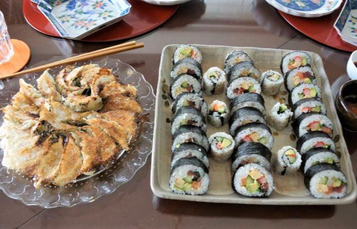 Platter of pan-fried dumplings (gyoza) and colorful Japanese sushi rolls