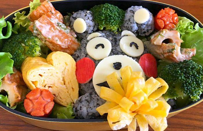 Bento with a cute black bear made of rice