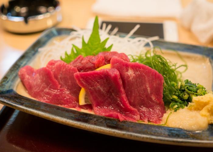 Close up image of horse meat sashimi